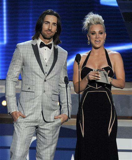 Actress Kaley Cuoco, right, and singer Jake Owen present the award for vocal group of the year at the 48th Annual Academy of Country Music Awards at the MGM Grand Garden Arena in Las Vegas on Sunday, April 7, 2013. <span class=meta>(AP photo)</span>