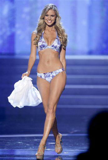 "<div class=""meta ""><span class=""caption-text "">Renae Ayris, Miss Australia, walks the stage during the swimsuit portion of the Miss Universe competition, Wednesday, Dec. 19, 2012, in Las Vegas.  (AP Photo/ Julie Jacobson)</span></div>"