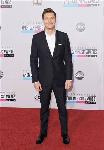 "<div class=""meta image-caption""><div class=""origin-logo origin-image ""><span></span></div><span class=""caption-text""> Ryan Seacrest arrives at the 40th Anniversary American Music Awards on Sunday, Nov. 18, 2012, in Los Angeles. (Photo by Jordan Strauss/Invision/AP)</span></div>"