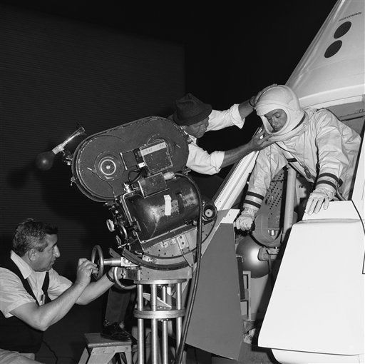 Filming on location at North American Aviation&#39;s Space Division in Downey, Cal. on June 4, 1965, producers of &#39;I Dream of Jeannie,&#39; a new TV series, prepare to walk a man in space on camera. From left to right, cameraman Sam Rosen and director Gero Nelson guide the co-star of the series, Larry Hagman, as he emerges from a lifesize mockup of the Apollo space vehicle that will be used to carry Americans to the moon. This foot-age, combined with special-effects material, will results in a scene in which Hagman appears to float in space. The series, a fantasy-comedy, is about the adventures of a young astronaut &#40;Hagman&#41; who crash lands near a desert island and finds an ancient bottle which turns out to be inhabited by a beautiful blonde genie played by Barbara Eden.  <span class=meta>(AP Photo&#47; Anonymous)</span>