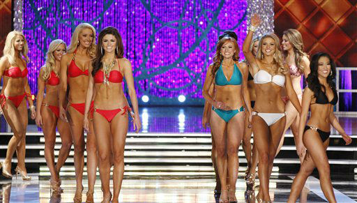 "<div class=""meta image-caption""><div class=""origin-logo origin-image ""><span></span></div><span class=""caption-text"">Contestants compete in the swimsuit portion of the Miss America 2013 pageant on Saturday, Jan. 12, 2013, in Las Vegas.  (AP Photo/ Isaac Brekken)</span></div>"