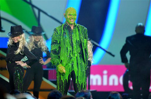 Pitbull is slimed at the 26th annual Nickelodeon&#39;s Kids&#39; Choice Awards on Saturday, March 23, 2013, in Los Angeles. &#40;Photo by John Shearer&#47;Invision&#47;AP&#41; <span class=meta>(Photo&#47;John Shearer)</span>