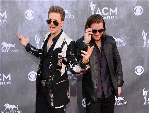 Brian Kelley, left, and Tyler Hubbard, of the musical group Florida Georgia Line, arrive at the 49th annual Academy of Country Music Awards at the MGM Grand Garden Arena on Sunday, April 6, 2014, in Las Vegas. &#40;Photo by Al Powers&#47;Powers Imagery&#47;Invision&#47;AP&#41; <span class=meta>(Al Powers&#47;Powers Imagery)</span>
