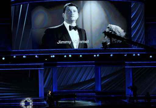 Josh Groban, left, and Jimmy Kimmel, onscreen, perform at the 64th Primetime Emmy Awards at the Nokia Theatre on Sunday, Sept. 23, 2012, in Los Angeles. &#40;Photo by John Shearer&#47;Invision&#47;AP&#41; <span class=meta>(Photo&#47;John Shearer)</span>