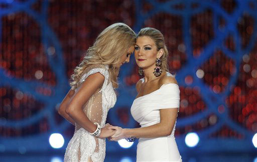 Miss South Carolina Ali Rogers, left, and Miss New York, Mallory Hytes Hagan, right, wait for the announcement of the winner during the Miss America 2013 pageant on Saturday, Jan. 12, 2013, in Las Vegas. Hytes Hagan won the competition.   <span class=meta>(AP Photo&#47; Isaac Brekken)</span>