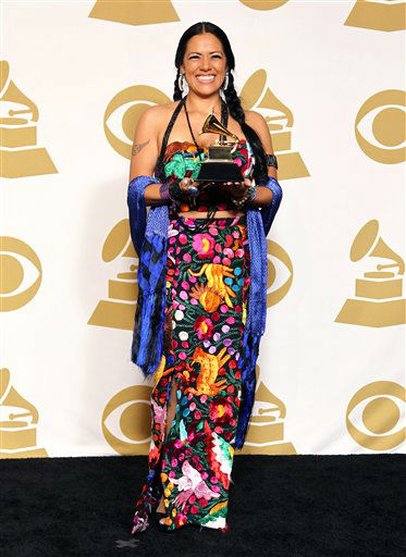 Lila Downs poses backstage with the award for regional Mexican music album &#40;including Tejano&#41; for the album &#34;Pecados Y Milagros&#34; at the 55th annual Grammy Awards on Sunday, Feb. 10, 2013, in Los Angeles. <span class=meta>(AP photo)</span>