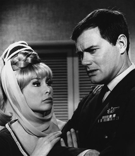 "<div class=""meta ""><span class=""caption-text "">FILE - In this 1967 file photo, Barbara Eden, left, and Larry Hagman are shown in a scene from, ""I Dream of Jeannie.""   (AP Photo/ Anonymous)</span></div>"