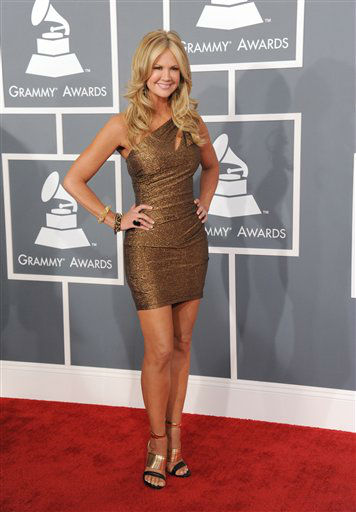 Nancy O'Dell arrives at the 55th annual Grammy Awards on Sunday, Feb. 10, 2013, in Los Angeles.