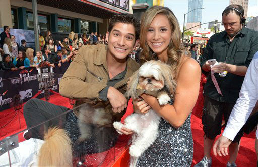 Tyler Posey, left, and MTV&#39;s Christina Garibaldi arrive at the 2014 MTV Movie Awards, on Sunday, April 13, 2014 in Los Angeles.  <span class=meta>(Photo by John Shearer&#47;Invision for MTV&#47;AP Images)</span>