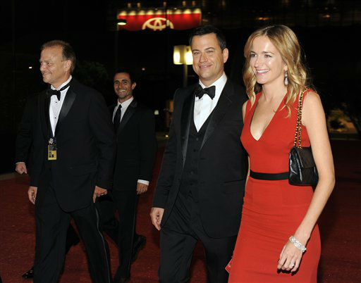 Jimmy Kimmel, center, and Molly McNearney arrive at the 64th Primetime Emmy Awards Governors Ball on Sunday, Sept. 23, 2012, in Los Angeles. &#40;Photo by Chris Pizzello&#47;Invision&#47;AP&#41; <span class=meta>(Photo&#47;Chris Pizzello)</span>