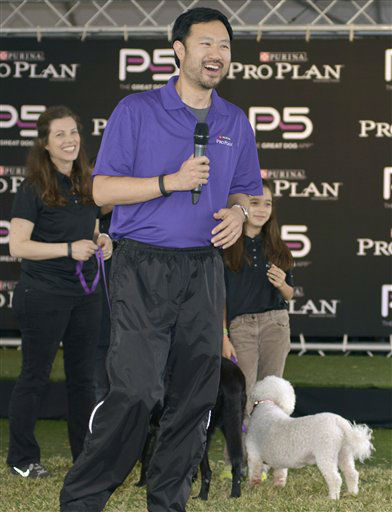 IMAGE DISTRIBUTED FOR PURINA PRO PLAN - Social media expert Peter Kim, joined by his family and their dogs, speaks to attendees about the Purina Pro Plan P5 mobile application during Purina Pro Plan Bark by Bark West, Saturday, March 9, 2013, in Austin, Texas. The event was held to demonstrate the great potential in all dogs through training techniques and nutritional information featured in the application. &#40;Photo by Darren Abate&#47;Invision for Purina Pro Plan&#47;AP Images&#41; <span class=meta>(Photo&#47;Darren Abate)</span>