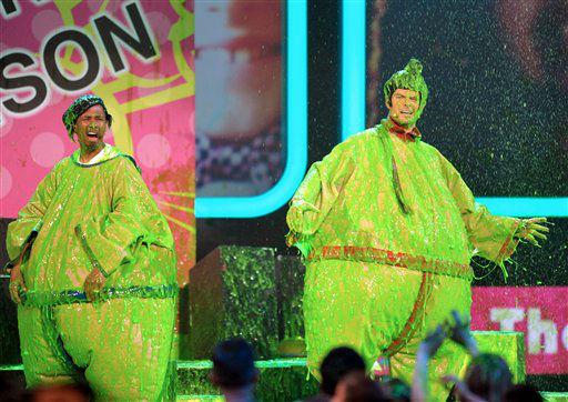 Josh Duhamel and Nick Cannon participate in a zipline race at the 26th annual Nickelodeon&#39;s Kids&#39; Choice Awards on Saturday, March 23, 2013, in Los Angeles. &#40;Photo by John Shearer&#47;Invision&#47;AP&#41; <span class=meta>(Photo&#47;John Shearer)</span>