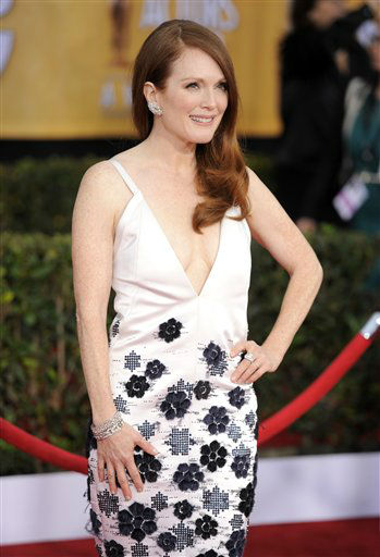 Julianne Moore arrives at the 19th Annual Screen Actors Guild Awards at the Shrine Auditorium in Los Angeles on Sunday, Jan. 27, 2013. &#40;Photo by Chris Pizzello&#47;Invision&#47;AP&#41; <span class=meta>(Photo&#47;Chris Pizzello)</span>