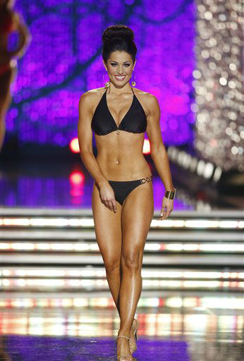 "<div class=""meta image-caption""><div class=""origin-logo origin-image ""><span></span></div><span class=""caption-text"">Miss Illinois Megan Irvin competes in the swimsuit portion of the Miss America 2013 pageant on Saturday, Jan. 12, 2013, in Las Vegas. (AP Photo/Isaac Brekken) (AP Photo/ Isaac Brekken)</span></div>"