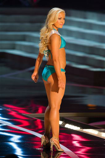 In this photo provided by the Miss Universe Organization,  Miss Idaho USA 2013, Marissa Wickland,  competes in her swimsuit during the  2013 Miss USA Competition Preliminary Show in Las Vegas on Wednesday June 12, 2013.   She will compete for the title of Miss USA 2013 and the coveted Miss USA Diamond Nexus Crown on June 16, 2013.   <span class=meta>(AP Photo&#47; Darren Decker)</span>