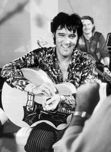 "<div class=""meta ""><span class=""caption-text "">Elvis Presley is shown in this 1970 photo, dateline unknown. To ensure Elvis fans and the general public don't forget the jumpsuit years, the Presley estate is re-releasing the 1970 concert film ``Elvis, That's The Way It is,'' with new concert footage. The 97-minute documentary on Presley's Las Vegas concerts will debut Saturday, Aug. 12, 2000, in Memphis, Tenn., as part of Elvis Tribute Week, the annual fan pilgrimage to the King's hometown to commemorate the anniversary of his death, Aug. 16, 1977. (AP Photo/Permission by Elvis Presley Enterprises) (AP Photo/ Anonymous)</span></div>"