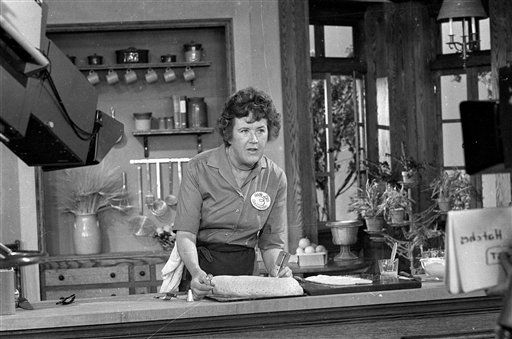 *** FILE *** Television cooking personality Julia Child prepares a French delicacy in her cooking studio in this Nov. 24, 1970 file photo. Child shared a secret with U.S. Supreme Court Justice Arthur Goldberg and Chicago White Sox catcher Moe Berg at a time when the Nazis threatened the world. They served in an international spy ring managed by the Office of Strategic Services, an early version of the CIA created in World War II by President Franklin Roosevelt. The secret comes out Thursday, Aug. 14, 2008, all of the names and previously classified files identifying nearly 24,000 spies who formed the U.S.&#39;s first centralized intelligence effort. The National Archives will make available for the first time all 750,000 pages identifying the vast spy network of military and civilian operatives. &#40;AP Photo&#47;FILE&#41; <span class=meta>(AP Photo&#47; XCJ AD MM**NY**)</span>