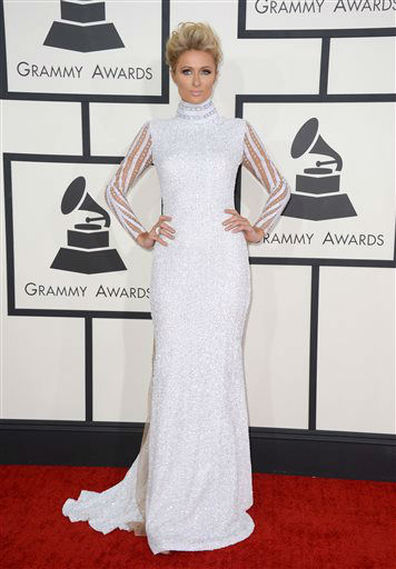"<div class=""meta image-caption""><div class=""origin-logo origin-image ""><span></span></div><span class=""caption-text"">Paris Hilton arrives at the 56th annual GRAMMY Awards at Staples Center on Sunday, Jan. 26, 2014, in Los Angeles.  (Photo/Jordan Strauss)</span></div>"