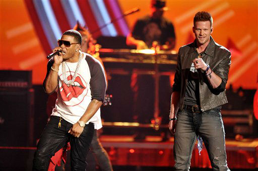 Nelly peforms with Brian Kelley of the musical group Florida Georgia Lineat the American Music Awards at the Nokia Theatre L.A. Live on Sunday, Nov. 24, 2013, in Los Angeles. (Photo by John Shearer/Invision/AP)