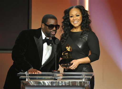 arryn Campbell, left, and Erica Campbell accept the best gospel song award for &#34;Go Get It&#34; at the 55th annual Grammy Awards on Sunday, Feb. 10, 2013, in Los Angeles.  <span class=meta>(AP photo)</span>