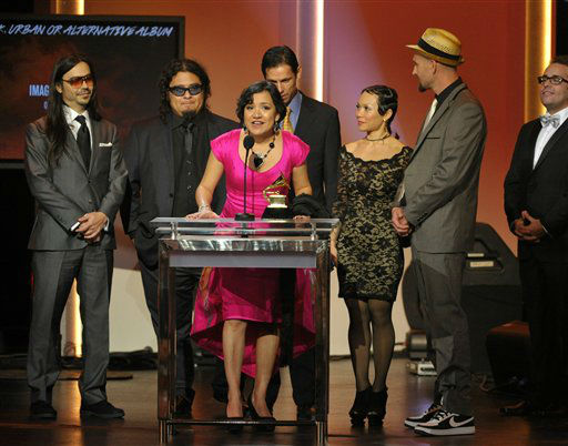 Martha Gonzales, center, with her band musical group Quetzal, accept the award for Latin rock, urban or alternative album for &#34;Imaginaries&#34; at the 55th annual Grammy Awards on Sunday, Feb. 10, 2013, in Los Angeles. <span class=meta>(AP photo)</span>