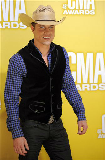 "<div class=""meta ""><span class=""caption-text "">Dustin Lynch arrives at the 46th Annual Country Music Awards at the Bridgestone Arena on Thursday, Nov. 1, 2012, in Nashville, Tenn.   (Photo/Chris Pizzello)</span></div>"