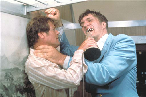 This undated publicity photo provided by United Artists and Danjaq, LLC shows Richard Kiel, right, as Jaws and Roger Moore, as James Bond, fighting in the 1977 film, &#34;The Spy Who Loved Me.&#34; Those teeth could do some serious damage. The film is included in the MGM and 20th Century Fox Home Entertainment Blu-Ray &#34;Bond 50&#34; anniversary set.  &#40;AP Photo&#47;United Artists and Danjaq, LLC&#41; <span class=meta>(AP Photo&#47; Uncredited)</span>
