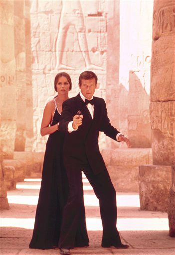 "<div class=""meta ""><span class=""caption-text "">This undated publicity photo provided by United Artists and Danjaq, LLC shows Roger Moore, right, as James Bond, and Barbara Bach as Major Anya Amasova, in the 1977 film, ""The Spy Who Loved Me."" Moore, played Bond in seven films, more than any other actor. The film is included in the MGM and 20th Century Fox Home Entertainment Blu-Ray ""Bond 50"" anniversary set. (AP Photo/United Artists and Danjaq, LLC) (AP Photo/ Uncredited)</span></div>"
