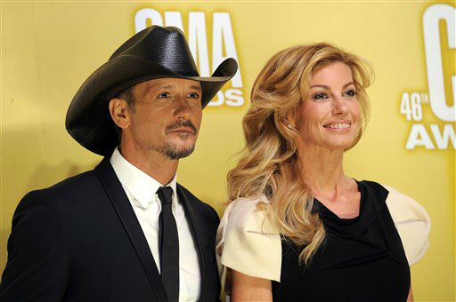 "<div class=""meta ""><span class=""caption-text "">Tim McGraw, left, and Faith Hill arrive at the 46th Annual Country Music Awards at the Bridgestone Arena on Thursday, Nov. 1, 2012, in Nashville, Tenn.  (Photo/Chris Pizzello)</span></div>"