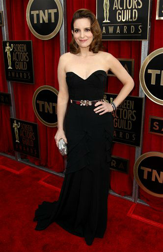"<div class=""meta image-caption""><div class=""origin-logo origin-image ""><span></span></div><span class=""caption-text"">Actress Tina Fey arrives at the 19th Annual Screen Actors Guild Awards at the Shrine Auditorium in Los Angeles on Sunday, Jan. 27, 2013. (Photo by Matt Sayles/Invision/AP) (Photo/Matt Sayles)</span></div>"