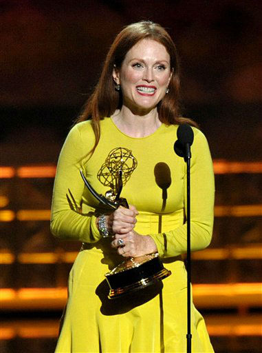 "<div class=""meta ""><span class=""caption-text "">Julianne Moore accepts the award for Outstanding Lead Actress In A Miniseries Or Movie for ""Game Change"" at the 64th Primetime Emmy Awards at the Nokia Theatre on Sunday, Sept. 23, 2012, in Los Angeles. (Photo by John Shearer/Invision/AP) (Photo/John Shearer)</span></div>"
