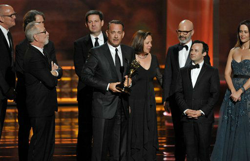 Tom Hanks, center, and the cast and crew of &#34;Game Change&#34; accept the award for outstanding miniseries or movie for at the 64th Primetime Emmy Awards at the Nokia Theatre on Sunday, Sept. 23, 2012, in Los Angeles. &#40;Photo by John Shearer&#47;Invision&#47;AP&#41; <span class=meta>(Photo&#47;John Shearer)</span>