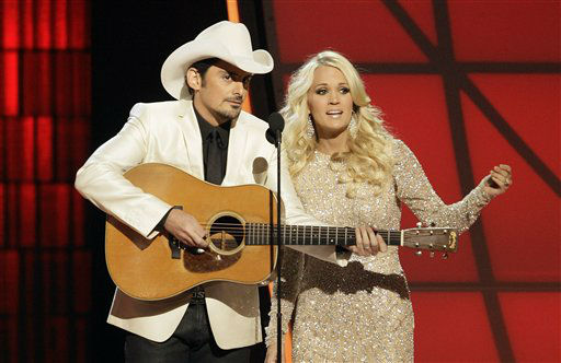 "<div class=""meta image-caption""><div class=""origin-logo origin-image ""><span></span></div><span class=""caption-text"">Hosts Brad Paisley, left, and Carrie Underwood perform an opening number onstage at the 46th Annual Country Music Awards at the Bridgestone Arena on Thursday, Nov. 1, 2012, in Nashville, Tenn.   (Photo/Wade Payne)</span></div>"