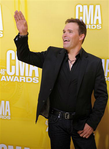 "<div class=""meta image-caption""><div class=""origin-logo origin-image ""><span></span></div><span class=""caption-text"">James Wesley arrives at the 46th Annual Country Music Awards at the Bridgestone Arena on Thursday, Nov. 1, 2012, in Nashville, Tenn.   (Photo/Chris Pizzello)</span></div>"