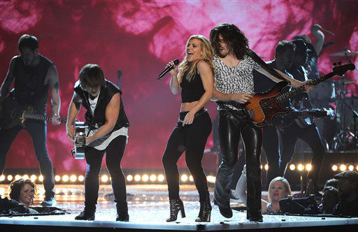 Neil Perry, from foreground left, Kimberly Perry and Reid Perry, of the musical group The Band Perry, perform at the 49th annual Academy of Country Music Awards at the MGM Grand Garden Arena on Sunday, April 6, 2014, in Las Vegas. &#40;Photo by Chris Pizzello&#47;Invision&#47;AP&#41; <span class=meta>(Photo&#47;Chris Pizzello)</span>