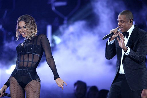 "<div class=""meta ""><span class=""caption-text "">Beyonce, foreground, and Jay-Z perform ""Drunk in Love"" at the 56th annual Grammy Awards at Staples Center on Sunday, Jan. 26, 2014, in Los Angeles.   (AP photo)</span></div>"