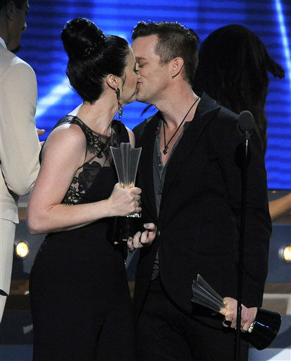 Shawna Thompson, left, and Keifer Thompson, of Thompson Square, kiss as they accept the award for vocal duo of the year at the 48th Annual Academy of Country Music Awards at the MGM Grand Garden Arena in Las Vegas on Sunday, April 7, 2013.  <span class=meta>(AP photo)</span>