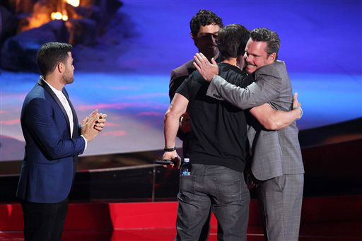 From left, Jerry Ferrara, Adrian Grenier and Kevin Dillon present the generation award to Mark Wahlberg, center, on stage at the MTV Movie Awards on Sunday, April 13, 2014, at Nokia Theatre in Los Angeles. &#40;Photo by Matt Sayles&#47;Invision&#47;AP&#41; <span class=meta>(Photo&#47;Matt Sayles)</span>