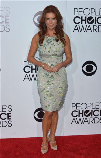 Roma Downey arrives at the 40th annual People's Choice Awards at Nokia Theatre L.A. Live on Wednesday, Jan. 8, 2014, in Los Angeles. (Photo by John Shearer/Invision/AP)