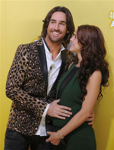 Jake Owen, left, and Lacey Buchanan Owen arrive at the 46th Annual Country Music Awards at the Bridgestone Arena on Thursday, Nov. 1, 2012, in Nashville, Tenn.   <span class=meta>(Photo&#47;Chris Pizzello)</span>