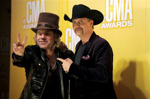 "<div class=""meta image-caption""><div class=""origin-logo origin-image ""><span></span></div><span class=""caption-text"">Big Kenny, left, and John Rich, of musical duo Big & Rich, arrive at the 46th Annual Country Music Awards at the Bridgestone Arena on Thursday, Nov. 1, 2012, in Nashville, Tenn.   (Photo/Chris Pizzello)</span></div>"