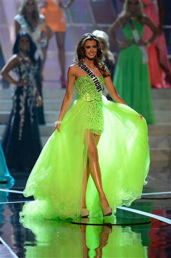 "<div class=""meta ""><span class=""caption-text "">Miss Connecticut Erin Brady, from Glastonbury, Conn., walks the runway during the introductions of the Miss USA 2013 pageant, Sunday, June 16, 2013, in Las Vegas.  (AP Photo/ Jeff Bottari)</span></div>"