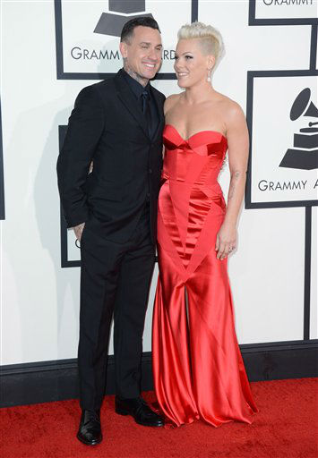 "<div class=""meta ""><span class=""caption-text "">Carey Hart, left, and Pink arrive at the 56th annual GRAMMY Awards at Staples Center on Sunday, Jan. 26, 2014, in Los Angeles.  (Photo by Jordan Strauss/Invision/AP)</span></div>"
