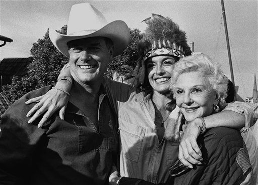 Famed actress Mary Martin, right, joins her son, actor Larry Hagman, left, and actress Linda Gray during party Hagman hosted at his Malibu, Calif., beach house on Sunday, June 30, 1980, for friends and cast members from the &#39;Dallas&#39; television series.   Miss Gray wears an Indian bonnet, part of the Western-style headgear worn by guests. Hagman and Miss Gray are featured performers in the show.   <span class=meta>(AP Photo&#47; Huynh   Nick Ut)</span>