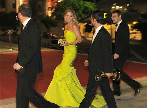 "<div class=""meta ""><span class=""caption-text "">Julie Bowen, center, winner of the award for outstanding supporting actress in a comedy series for ""Modern Family,"" arrives at the 64th Primetime Emmy Awards Governors Ball on Sunday, Sept. 23, 2012, in Los Angeles. (Photo by Chris Pizzello/Invision/AP) (Photo/Chris Pizzello)</span></div>"