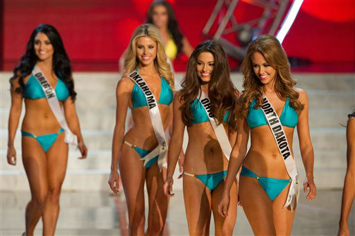 In this photo provided by the Miss Universe Organization,  Miss North Dakota USA 2013, Stephanie Erickson; Miss Ohio USA 2013, Kristin Smith; Miss Oklahoma USA 2013, Makenzie Muse; and Miss Oregon USA 2013, Gabrielle Neilan; compete in their swimsuits during the  2013 Miss USA Competition Preliminary Show in Las Vegas on Wednesday June 12, 2013.   She will compete for the title of Miss USA 2013 and the coveted Miss USA Diamond Nexus Crown on June 16, 2013.   <span class=meta>(AP Photo&#47; Darren Decker)</span>