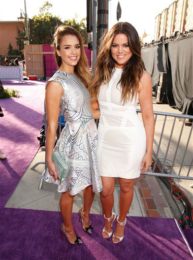Actress Jessica Alba, left and Khloe Kardashian arrive at the 26th annual Nickelodeon&#39;s Kids&#39; Choice Awards on Saturday, March 23, 2013, in Los Angeles. &#40;Photo by Todd Williamson&#47;Invision&#47;AP&#41; <span class=meta>(Photo&#47;Todd Williamson)</span>