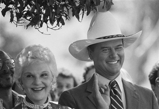 Actor Larry Hagman putting on his best J.P. Ewing look, his mother, Mary Martin, left, smile to the audience in Hollywood who were viewing the placement of his star in the Hollywood Walk of Fame in Los Angeles   <span class=meta>(AP photo)</span>