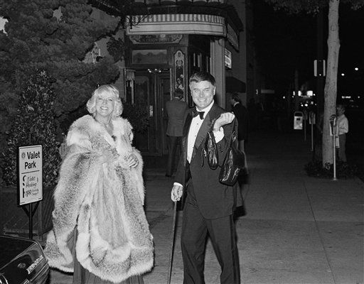 Maj and Larry Hagman pause briefly for photographers outside Le Bistro in Beverly Hills on Saturday, Nov. 7, 1981, where they joined other celebrities during a dinner hosted by former President and Mrs. Gerald Ford in honor of Jordan&#39;s King Hussein and Queen Noor.  <span class=meta>(AP Photo&#47; Lennox McLendon)</span>