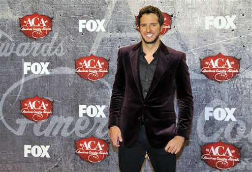 Singer Luke Bryan poses in the press room after winning multiple awards backstage at the American Country Awards on Monday, Dec. 10, 2012, in Las Vegas. &#40;Photo by Jeff Bottari&#47;Invision&#47;AP&#41; <span class=meta>(Photo&#47;Jeff Bottari)</span>